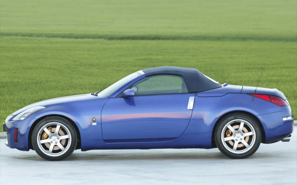 <p>Nissan brought back its storied Z-car as the all-new 350Z sport coupe in 2002 and a 2-seater ragtop for 2004, complete with a 1-latch power top and heated rear window. The automaker's rear-drive FM chassis drives exceedingly well, lending the Z good balance and precise road-carving ability. It uses the all-aluminum DOHC 3.5-litre V-6 out of the Altima, but with slightly hotter camshafts and freer-flowing intake and exhaust systems, resulting in 287 romping horses (the 2006 manual-transmission models gained an upgraded 300-hp engine). In addition to the stick, Nissan offered a reliable 5-speed conventional automatic in the Z – no CVTs for this car.</p> <p></p>