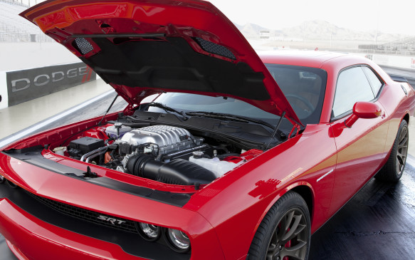 <p><strong>2015 Dodge Challenger SRT Hellcat (6.2-litre supercharged OHV V-8) - </strong>You have to hand it to the engineers at Fiat Chrysler who were somehow able to make the business case for a supercharged 6.2-litre V-8 that produces 707 horsepower and 650 lb-ft of torque. But such things should be celebrated, especially how well integrated it is into the revised Dodge Challenger. The long list of upgraded near-race-spec bits to ensure it lasts for years to come. Tested with the new eight-speed automatic that defaults to fuel-saving early up-shifts that helped Ward's editors to burn 15.6 L/100 km or less, when called upon, is the quicker-accelerating of the two available transmissions. Simply riotous fun.</p>