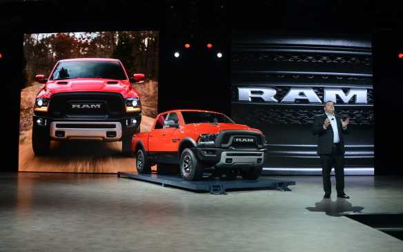 <p><strong>2016 Ram 1500 Rebel</strong></p> <p>Ram keeps offering an expanding number trims of its popular 1500 pickup, and the new Rebel is the most distinctive yet. It gets an all-new blacked-out grille and front bumper, aluminum hood, dark fender extensions, and an enormous RAM script stamped into the tailgate. The 17-inch wheels are wrapped in meatier 33-inch off-road tires, and the standard air suspension sits around two centimetres taller than normal. The interior gets colour-matched accents, along with a tread-pattern embedded in the seats. Power comes from the 305-horsepower 3.6-litre V-6 with four-wheel drive and a 3.92 gear ratio; the 395-horse 5.7-litre HEMI V-8 is available in either rear- or four-wheel drive. Eight-speed automatic transmissions are standard across the board.</p>