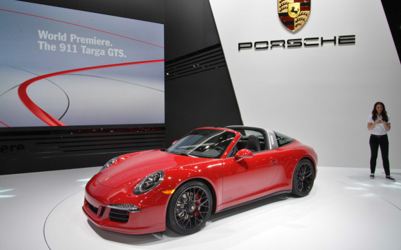<p><strong>2015 Porsche 911 Targa GTS</strong></p> <p>Porsche's reborn Targa perfectly exemplifies its technological progress in the last 40 years. Where once the Targa had simple removable roof panel, it now features one of the most dizzyingly complex automated roof systems around. Much was made of the Targa's blunted performance thanks to the added weight, so Porsche is responding by offering it in GTS trim. The GTS gets an extra 30 horsepower from its 3.8-litre flat-six engine, which when equipped with the optional seven-speed PDK transmission, gives 0-96 km/h (0-60 mph) times of only 4.1 seconds. The GTS also includes the popular Sport Chrono, active suspension, sport exhaust and 20-inch centre-lock wheels, which are usually expensive extras. </p>