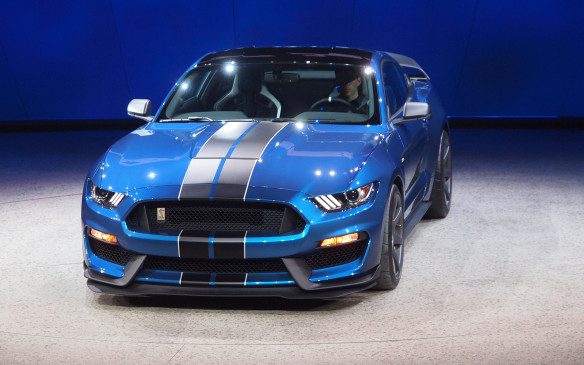 <p>2016 Ford Mustang Shelby GT350R</p> <p>For those who may find the regular Mustang Shelby GT350 too soft, Ford is offering an R version that should quell those complaints. The R shares the same 5.2-litre 'flat-plane-crank' V-8 engine with over 500 horsepower and six-speed manual transmission, but goes even battier. There's an enormous fixed rear wing, which complements the larger Shelby-etched front splitter, and larger hood scoop to aid cooling. Track-ready seven-spoke wheels cover upgraded brakes and stickier tires, and Ford's first application of magnetic variable-resistance dampers. And to help save weight, there's no rear seat or air conditioning. Can't wait for the twin-test against the Chevrolet Camaro Z/28.</p>