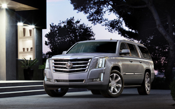 <p><strong>CUVs & SUVs: </strong><strong>Cadillac Escalade –</strong> While most of the action in the SUV classes is taking place further down the ranks, especially at the 'soft-roader' CUV level, Cadillac stuck to the script in redesigning its big 'King-of-the hill', body-on-frame Escalade. Essentially all-new, it continues to embrace the brand's hard-edged design idiom and box-like profile.</p>