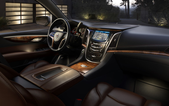 <p><strong>CUVs & SUVs: </strong><strong>Cadillac Escalade – </strong>Powered by a thoroughly-modern, albeit OHV, 6.2-litre V-8, it's no slouch in getting around, nor in its amenities. Within its luxurious cabin it's also at the cutting edge of connectivity, featuring 4G LTE technology and an in-vehicle wi-fi hotspot. It's full value for its selection as one of Playboy's cars of the year.</p>
