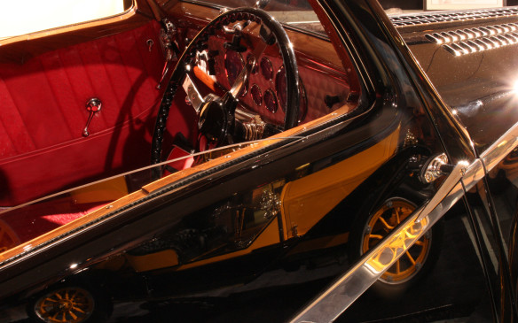 <p>There's beauty inside the cars too, and also in the reflections. Note the wood and leather and the engine-turned instrument surround.</p>
