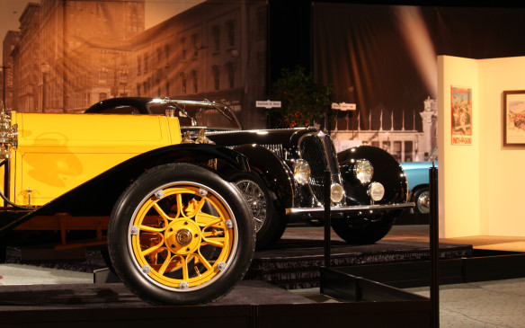 <p>The Stutz Bearcat shares centre-stage with an ultra-rare and valuable French Delahaye. The art wall in the background features artwork by Ken Dallison, one of two internationally renowned autonotive fine artists, along with jay Koka, who are featured in the exhibit.</p>