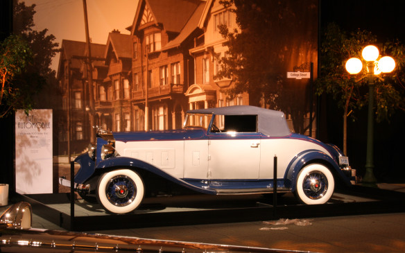 <p>Style continued to evolve even during the depression years, as cars like this Packard 'Light Eight' demonstrates with its sculpted 'Shovel Nose' variation of Packard's ox-yoke grille and sweeping fender lines, highlighted by detailing, inside and out, that characterized the premium cars of the Grand Classic era. It's parked against a backdrop of period houses in the College Street area.</p>