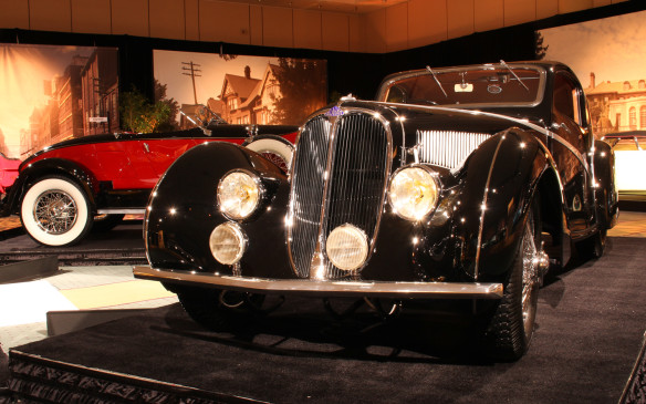 """<p>This 1936 Delahaye Type 135 Competition Court Teardrop Coupe is arguably the superstar of the show. The most exotic designs of the Art Deco era were those of French coachbuilders whose work became synonymous with the """"French curve."""" Among the most prominent was Figoni et Falaschi, which built the body for this Delahaye– one of just three of its type. It was Best in Show winner at the 2014 Cobble Beach Concours d'Elegance.</p>"""
