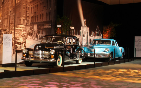 """<p>In this setting the '48 Tucker is parked behind a 1941 Cadillac60 Special Sedan, also from the Gilmore Museum. The 60 Special, designed under the direction of Harley Earl and Bill Mitchell, set the tone for 1940s design with such trend-setting features as a completely integrated, coupe-like trunk (three-box"""" sedan styling), no running boards, four front-hinged doors, raked windshield and lowered roofline.</p>"""