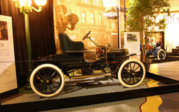 <p>This 1911 Brush, also featured in Murdoch Mysteries, is displayed outside the entrance to the Art and the Automobile gallery. Brush automobiles were low-priced transition points from the buggy age to the automobile age, as this vehicle illustrates. Relying on wood frame construction with little more than self propulsion to offer beyond a buggy, Brush was one of many early automakers that failed to survive.</p>