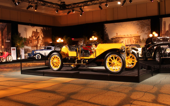 <p>Inside, a magnificent array of cars, like this 1913 Stutz Bearcat in the foreground, are presented in an art gallery-like setting to reinforce the art connection. More than just a collection of pretty cars, the vehicles on display were chosen to illustrate the artistic evolution of automotive design over almost a century from the automobile's inception into the 1960s. Not only are automobiles in their finest forms, woeks of art themselves, they have long been the subjects of works of art, some of which are also displayed in the exhibit. </p>