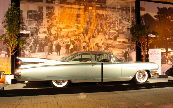 <p>The aircraft influence on styling led directly to the finned era, which reached its zenith in the flamboyant and outrageous 1959 Cadillac Eldorado Seville. Perhaps the most memorable Cadillac ever produced, it marked the end of that cycle of excess, beginning a pendulum swing that would lead to the opposite extreme. In the background is the floor of the 1958 CNE Auto Show in the Automotive Building.</p>