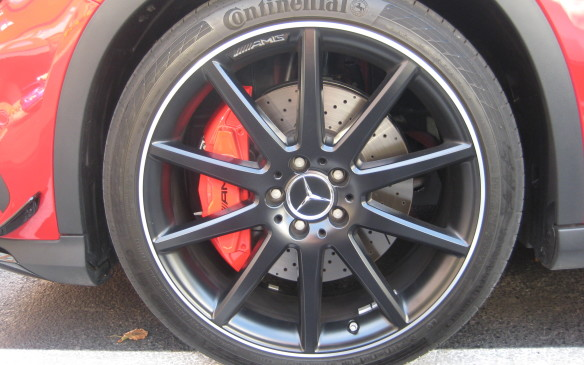 <p>The GLA rides on standard 18-inch, five-twin-spoke alloy rims fitted with 235/50 R18 all-season run-flat tires while the GLA 45 AMG has its own standard 19-inch, five-twin-spoke rim fitted with 235/48 R19 performance tires. Opting for the sport package upgrades the wheel/tire combination, with the GLA 250 getting a 19-inch, five spoke AMG wheel and 235/45 R19 all-seasons or an optional variation on the five-twin-spoke design, 19 inches in diameter. GLA 45 AMG buyers can choose a 20-inch 10-spoke alloy rim with 235/40 R20 performance tires or an optional black-painted version, shown here. The AMG performance tires, however, seemed to transfer considerable noise to the cabin and, not surprisingly, were less compliant than the standard GLA 250 package. They did delver a firm grip on the road, though.</p>