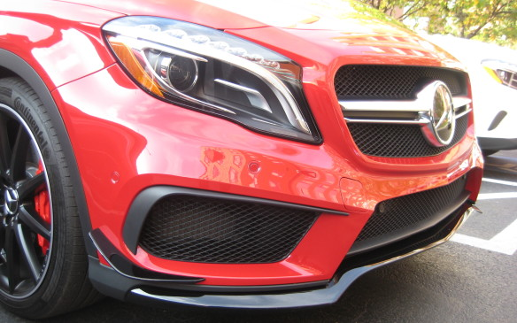 <p>In addition to its potent engine and specially tuned seven-speed transmission, the GLA 45 AMG is fitted with special functional features and unique trimmings inside and out. The exterior features a twin-blade AMG grille, special front apron with a splitter and black vanes on the outer air intakes, a lowered sports suspension, Bi-xenon headlamps, side sill inserts, unique rims and performance-rated tires, a sports exhaust system that barks and snarls in way that enthusiasts will love and a rear diffuser, trimmed in matte titanium grey.</p>