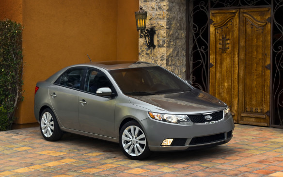 "<p>2010-13 Kia Forte</p> <p>The California-designed Forte arrived on a fresh front-drive platform just in time to replace the forgettable Spectra. The crisply creased Forte took the shape of a four-door sedan and two-door ""Koup;"" a five-door hatchback debuted for 2011. Despite a 4-cm-longer wheelbase, passenger volume was reduced a smidge compared to the Spectra, but it was still generous for a compact. Trunk capacity grew thanks to a less intrusive torsion-beam rear suspension that replaced the independent multilink setup.</p>"