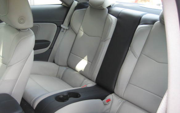 <p>Seating capacity is less in the coupe – the rear seat is limited to two occupants, while the sedan can accommodate three. The coupe's lower roofline also results in less head room – 955 mm in the front seats versus 980 mm in the sedan; the rear seat head room is 892 mm compared to the sedan's 935 mm. Front leg room is almost identical (1,074 mm in the coupe, 1079 in the sedan) while rear-seat leg room is exactly the same in both models (851 mm.) There's a slight difference in front shoulder room (1,374mm in the coupe, 1,402 in the sedan) while the difference is more noticeable in the rear seat – 1,298 mm, coupe; 1,370mm, sedan. Finally, front-seat hip room is more generous in the coupe (1,374 mm) compared to the sedan (1,345 mm), but is noticeably more limited in the coupe's rear seat – 1,130 mm versus 1,328 in the sedan.   </p>