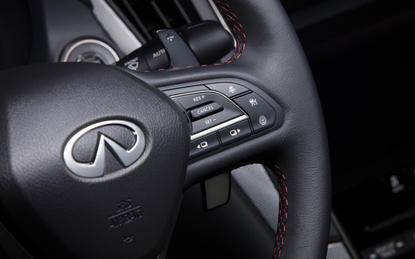 <p>All Q50s have the same 7-speed automatic transmission. Its shifter paddles, standard on the Red Sport, are now mounted directly to the steering wheel, not on the steering column as before.</p>