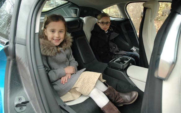 <p>Who woulda thunk it – the i8 has back seats! The rear cabin is obviously best suited to children like 7-year-old twins Sienna and Nathan, but we did manage to squeeze in adults, too (after making sure the combined weight of all occupants and their stuff would not exceed the max payload).</p>