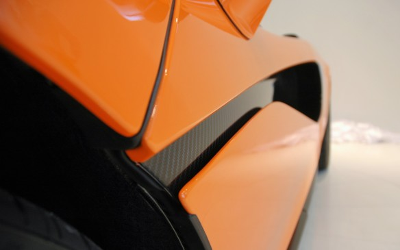 <p>While the carbon-fibre finish is an extra-cost option, all 570S's have this distinctive sculpting of the body-side ducts, which start narrow at the front here, and then broadens towards the openings that feed air to the engine intake and the cooling radiators.</p>
