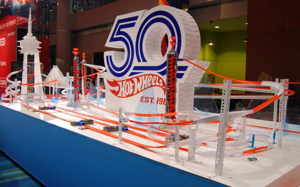 """<p>The <a href=""""https://autofile.ca/en-ca/auto-news/hot-wheels-celebrates-50-years-at-toronto-auto-show"""">Hot Wheels 50th-Anniversary display</a> includes this super track, which will definitely make your kids happy,and may make you happy too. Occasionally a car flies off the track and if you're quick, you can scoop it up to take home. There are Hot Wheels to buy, colour, build and play with throughout the 10 days of Auto Show. So bring the kids - and have some fun yourself!</p>"""