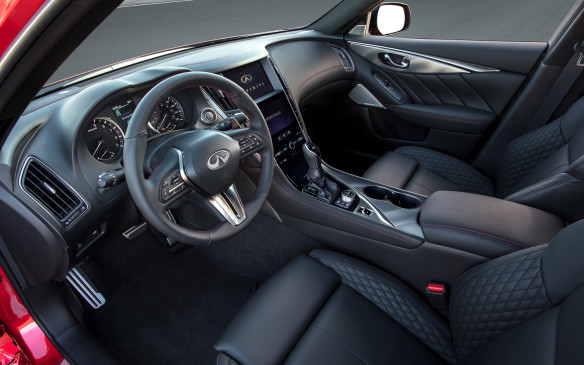 <p>That steering wheel is redesigned as a three-spoke wheel that's similar to the Q60's, and the transmission shifter knob in the centre console also has a different look and feel.</p>