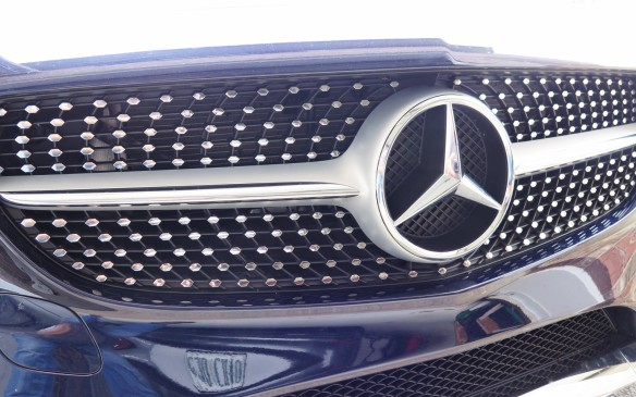 <p>The egg-crate grille of the Sport trim has chrome tips to differentiate it from the base model. (Editor's note: Was the Mercedes designer inspired by a 1958 Cadillac?)</p>