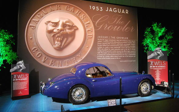 """<p>This year's <a href=""""https://autofile.ca/en-ca/car-photos/goddesses-and-gazelles-highlight-classic-car-display-at-cias"""">Art & the Automobile feature</a> is named """"Jewels"""", a rather fitting theme that applies to the craftsmanship that goes into the creation of not only the cars themselves but their iconic badges and hood ornaments, helping to identify them visually to car lovers everywhere. Seen in this photo is a1952 Jaguar XK120 FHC.</p>"""