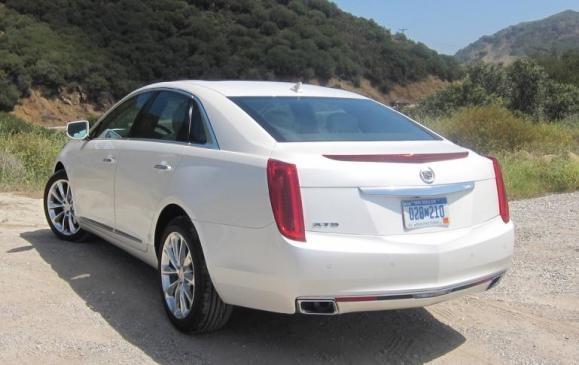 2013 Cadillac XTS - rear 3/4 scenic