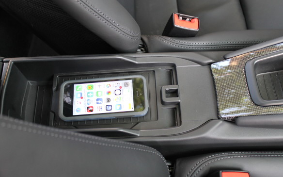 <p>For the first time, the 911 includes a recharging tray for your cell phone (though iPhones need a special case to recharge) that is also connected to an antenna at the front of the car.</p>