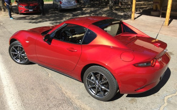 <p>Mazda has determined, however, that there are some folks who love the top-down experience but also want the comfort and security of a solid roof over their head. So, in response, the Mazda MX-5 RF is joining the fourth-generation MX-5's 2017 lineup.</p>