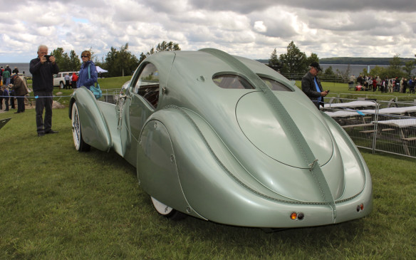 <p>Attendees entering or leaving the show field filed past this spectacular 1935 Bugatti Type 57 Aerolithe Elektron reproduction on display. The original Aerolithe, which was built specifically for the 1935 Paris Motor Show, has long-since disappeared. This recreation was constructed on another Type 57 chassis, here in Canada, by the Guild of Automotive Restorers, using the same unique materials.</p> <p>The 2016 Cobble Beach Concours d'Elegance is scheduled for September 17 & 18, 2016.</p>