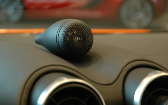 <p>It looks like somebody left a microphone lying on top of the instrument panel, but this is actually one of the 12 speakers for the available Bowers & Wilkins audio system.</p>
