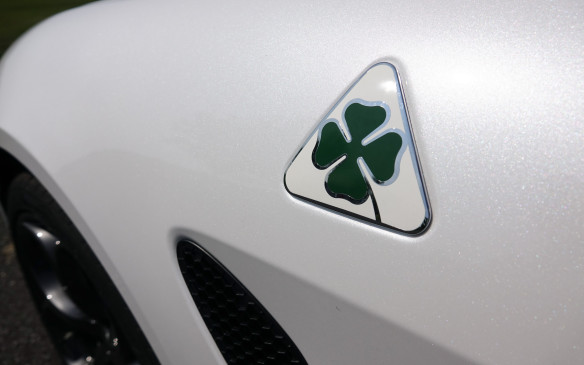 <p>The name Quadrifoglio simply evokes the four-leaf clover that has adorned Alfa Romeo race cars since the 1923 edition of the legendary Targa Florio. That year, Italian works driver Ugo Sivocci had finally won this mythical road race after decorating his red Alfa Romeo racer with a large green clover on a white square, for good luck. The famous logo was also subsequently used on performance versions of production models at Alfa Romeo, starting in the '60s. The metalflake-like, Trofeo White tri-coat paint on our test car is a $2,500 extra.</p>