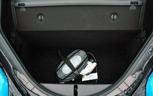 <p>The only cargo compartment is in the tail, behind the bulge that contains the gasoline engine. Here the space is partly occupied by the portable 110-volt charging cable. If you can afford the car you can also afford to have BMW install the 240-V WallBox charger. The WallBox Pro version can even be integrated into your home solar-panel array.</p>