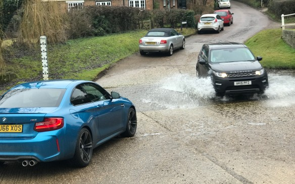 <p>Normally, the river is very shallow at this point, though fast moving, and it helps clean the mud from under your car. It can get deep sometimes, however, as the depth pole attests.</p>