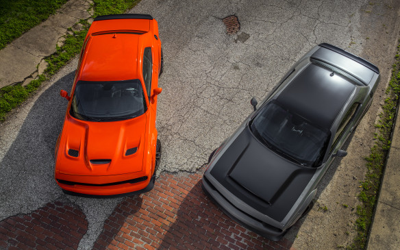 "<p>For the <a href=""http://www.autofile.ca/en-ca/auto-articles/muscle-and-luxury-highlight-fcas-2018-lineup"">2018 model year</a>, the SRT group, Fiat Chrysler Automobile's performance division, is introducing not one but a pair of spectacular variations on the Challenger Hellcat theme, introduced in 2015. The Hellcat Widebody and Demon share wider bodywork and most mechanical components but their respective missions are quite different. As the Widebody heads for the track, the fearsome Demon is – quite literally – geared for dominance on the traditional quarter-mile dragstrip. So let's see how these speed devils compare.</p> <p>By Marc Lachapelle</p>"