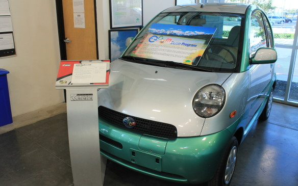 <p>And tucked in a corner, next to some electric cars, is the experimental e.com, a sub-compact car developed in California to be both practical and economical.</p>