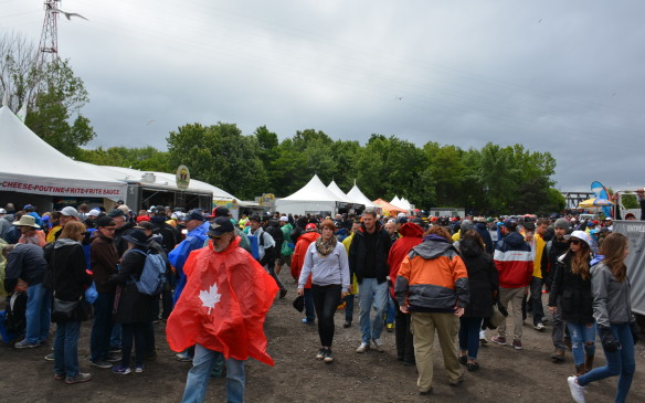 <p>As you move away from the paddock and pit area, you start to notice the sheer volume of people that surround the 4.361 km of Circuit Gilles Villeneuve. It's hard to walk around and find a spot to watch, but that's just part of the Formula One weekend as you mingle with fans from other countries and supporters of various teams. It's a true global affair, but one vastly different and more crowded than the security and quiet surroundings found in the paddock area.</p>