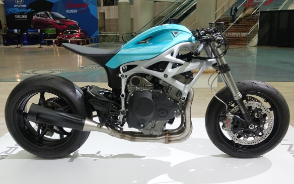 <p>In addition to the Blade, Divergent 3D had this surprise for visitors entering the South Hall at the L.A. Auto Show. The Dagger prototype is a superbike that combines the explosive, supercharged, 201- horsepower, 998cc four-cylinder engine from the current Kawasaki Ninja H2 with a 3D-printed frame, rear swingarm and fuel tank.</p>