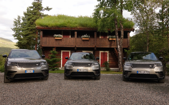 <p>Green roofs that keep houses warm in winter and cool in summer are quite common in Norway. They were in abundance at the charming Storfjord Hotel, our last overnight stop in the country. Judging by their license plates, the three Velar First Edition models posing in this photo are marked for future service in the Italian and German press vehicle fleets.</p>