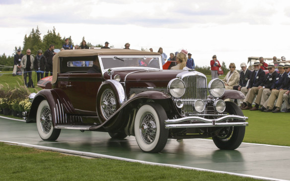"<p>Here's a better look at that Duesenberg – a 1930 Model SJ Convertible Victoria, with body by Rollston, which was once owned by orchestra leader Paul Whiteman – the ""King of Jazz."" Originally an un-supercharged model J, it is one of 36 Duesies upgraded to supercharged SJ specifications during the car's production period.</p>"