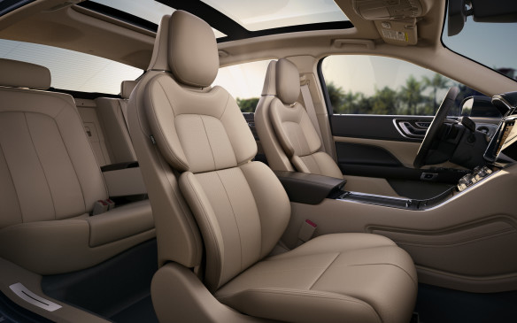 <p>There's plenty of space inside for four or five adults if they're not too tall. The roof height is a little low for rear-seat passengers. I'm six feet tall and my hair brushed against the headliner.</p>