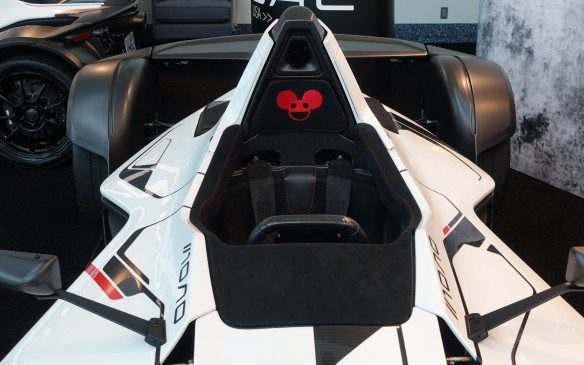 <p>One of the two BAC Mono supercars on display at the L.A. Autos Show belongs to artist and musician deadmau5 (pronounced 'dead mouse'), civilian name Joel Thomas Zimmerman, born and raised in Toronto. The world-famous DJ and producer had his round-eared red logo stitched on the roll hoop-mounted headrest.</p>