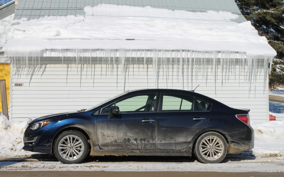<p>Most media drives take place in pleasant climes such as southern California or Europe where keeping cars clean for photography isn't a challenge. It didn't take long for the Impreza to start getting dirty on the real winter roads of Ontario. There'd been a heavy snowfall that week and the roads were only recently plowed.</p>