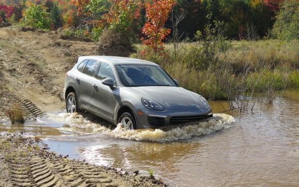 <p>Porsche Cayenne crossing stream</p>