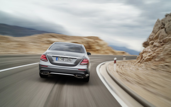<p>I'm still not sure why one would ever need to, but the E-Class can make a lane change autonomously if you hold the indicator lever for two seconds in the direction you wish to go. The car will then move into that lane as long as it is clear. Turning the steering wheel would seem just as easy.</p>