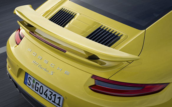 <p>They're easily recognizable from other 911s, however, by their permanently extended rear spoilers – which extend even farther at speed – and their three-panel air intakes on the rear lid, as well as air intakes on the rear fenders for the intercoolers.</p>