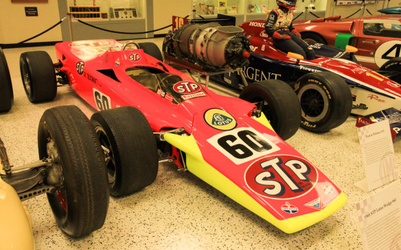 <p>This 1968 Lotus Wedge turbine car, entered by STP mogul Andy Granatelli, was even more revolutionary, in terms of both its aerodynamics and its gas turbine engine. Joe Leonard put the car on the pole and was leading with just nine laps to go when both it and a sister car dropped out with identical fuel-pump driveshaft failures. They were the last turbine-powered cars to race at Indy. But the wedge shape was quickly adopted by other competitors.</p>
