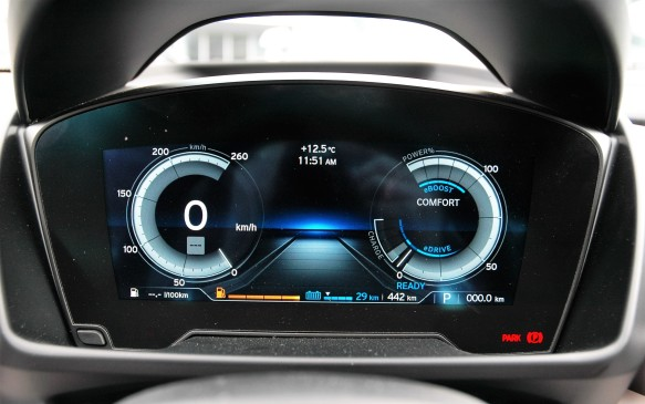 "<p>This is the default gauge display with the two main ""virtual"" dials showing speed on the left and electricity flows on the right, with EV range (in blue) and overall range (white) at the lower right. In Sport mode the gauges turn orange, and the one on the right becomes a tachometer.</p>"