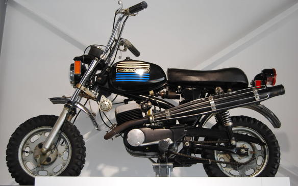"""<p>The X-90, built in Italy by Aermacchi, was added to the Harley-Davidson line-up during the period when the brand was owned by AMF. Best known at the time for producing sports equipment, AMF led Harley-Davidson to produce small, road-worthy mini-bikes like the """"Sportster,"""" a 60cc engine recreational road bike, and the X-90, a mini-bike with a 90cc engine. Sold between 1973 and 1975, the X-90 was intended to introduce children to the Harley-Davidson brand, much lik the MM5A was to do for Indian.</p> <p>It would seem the efforts of both firms failed due to their associations with larger more powerful machines; however, mini-bikes did go on to become a stepping stone into more advanced levels of motorcycle racing.</p>"""