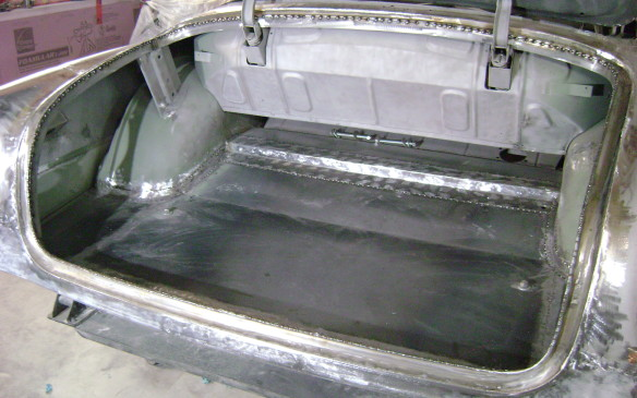 <p>Here's the trunk after a new floor and other components had been built and welded in place along with the fenders. Hundreds of spot welds ensure proper position. They will be ground down during final body work.</p>